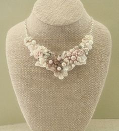 Blush Bridal Bib Necklace- Champagne Pink Wedding Statement Necklace- Rosette, Vintage jewelry, Pearls, Lace, & Rhinestones. $75.00, via Etsy.