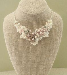 Blush Bridal Bib Necklace- Champagne Pink Wedding Statement Necklace- Rosette, Vintage jewelry, Pearls, Lace, & Rhinestones. $75.00, via Etsy.