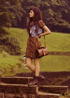 floral dress, boots, and denim vest