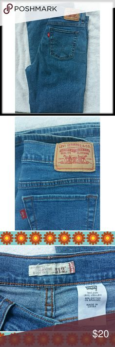 """Levi's 512 Perfectly Slimming Jeans Bootcut-6S A perfect pair of Levi's 512 perfectly slimming boot cut jeans!  High waist, bright, medium blue wash with no wear or stains. Size 6 Short,  14.5"""" across waistband,  11"""" rise, 29"""" inseam. Levi's Jeans Boot Cut"""