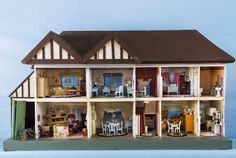 Masterfully designed by carpenters and engineers, the stately house features shrunken versions of then-contemporary floral wallpaper, stucco walls, and mullioned glass windows. Value: $2,000 Start collecting: dollshousespastandpresent.com
