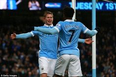 Kevin De Bruyne (left) celebrates a goal against Southampton with fellow expensive-signing, Rahe...