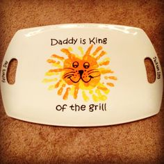 Father's Day gift ideas. Bought dish at bed bath  beyond. Ceramic paint. Steady hand to draw and tiny hand prints from one very loving son. Daddy is King of the Grill!