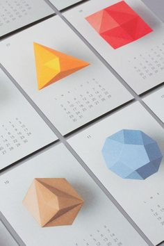 One thing i like about this one is how they have used the shapes on each of the calendars. Although the shapes might not have a meaning they work really well because its kept so consistent throughout. Another idea for something similar to this would be maybe to use different icons to represent the month of the year.  For example maybe use star signs for the different months or different weather icons such as winter or autumn depending on the month.