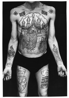 "Russian criminal tattoos.  ""Text on the right wrist reads: '1975-1984 ITK' (Ispravitelno Trudovaya Koloniya) '1975-1984 Correctional Labour Colony', the rose above the ..."""