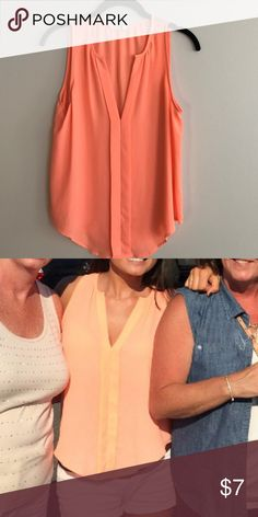 Neon Tank top color is a peachy neon with a vneck in the front. It looks great with a tan ☀️ Lush Tops Tank Tops
