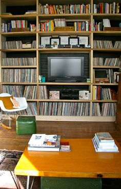If you have to have a tv, might as well surround it with books and records.