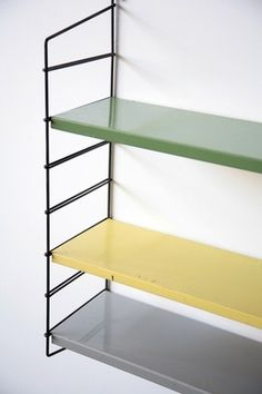 TOMADO STYLE INDUSTRIAL METAL SHELVING  Black Metal Uprights with Green, Grey and Yellow Enameled Metal Shelves