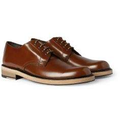 ACNE  BLEEKER CONTRAST-SOLE LEATHER DERBY SHOES A combination of high-shine leather and untreated soles makes Acne's Derby shoes a raffish city choice. Wear this rich chestnut-brown pair to punctuate a muted grey and blue palette for effortless flair when perusing the weekend markets.