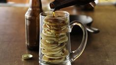 Nothing says manly-man food like a meal made of beer, bacon and pancakes. Stir candied bacon and your favorite beer into Bisquick to make these larger-than-life mancakes.
