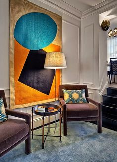 Hanging a rug or textile can provide a large scale piece of Art with added dimension and texture…k