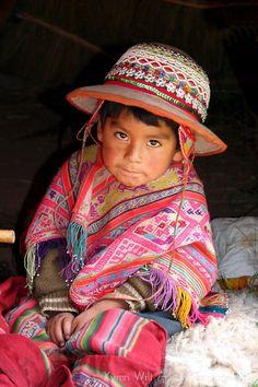 South America, Peru, Cusco. Young Peruvian boy in traditional dress.
