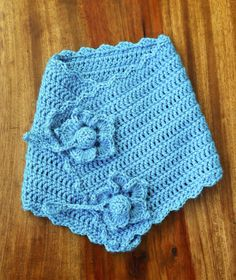 Crochet blue cowl with flowers