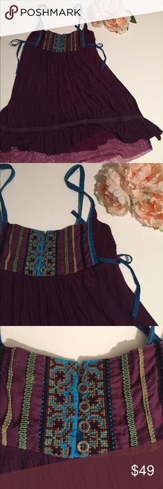 """Free People babydoll tank Adorable and gorgeous all at once. Beautiful plum colored bodice has plum tulle peeking out at the hem. Lots of Hippy-Dippy details in front - cross-stitch, buttons and rick-rack. Measures approximately 14"""" across the chest and approximately 29"""" long. Adjustable button spaghetti straps. Free People Tops Tank Tops"""