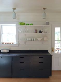Butcher block kitchen island by Siosi Design, Black Tolix Stools, Goode Kitchen, Amagansett | Remodelista