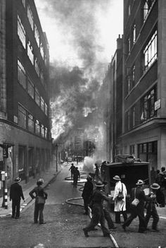 The London Auxiliary Fire Service fighting a fire near Whitehall road caused by an incendiary bomb. Photograph by William Vandivert. London, 1940.