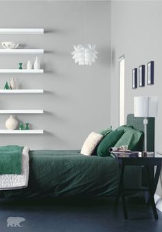 Who doesn't love a design style that balances sleek lines with pops of color, check out this modern decor? With accents of emerald green, this decor featuring BEHR paint in Evaporation would be ideal for a guest bedroom makeover.