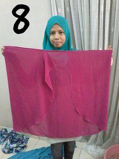 Nota Editor: Tutorial ini telah dikongsikan di Facebook Aimi Shukri dan kami telah diberi keizinan untuk kongsikan semula di sini. Semoga bermanfaat untuk para wanita dan gadis. Pernah dengar instant shawl dua muka yang tengah top sekarang ni? Cantikkan bila pakai? Sarung je. Mudah, cepat, kemas, ringkas & vouge gitu Hari yang indah ni Aimi nak share cara buat instant shawl 2 muka menggunakan shawl halfmoon yang dah sedia ada dalam wardrobe kita. Tak payah beli baru. Guna je yang sedia ad... Niqab Fashion, Batik Fashion, Hijab Casual, Hijab Chic, Dart Shirts, Abaya Pattern, Instant Hijab, Mode Abaya, Turban Hijab