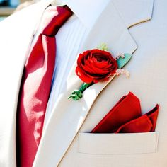Red Ranunculus Boutonniere // photo by: Elevate ... | Boutonnieres