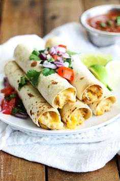 Flavorful creamy chicken made in the slow cooker, then rolled up in soft tortillas and baked or a few minutes until crispy! Perfect for taquito lovers!