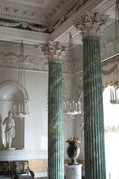 The magnificent mouldings on the ceiling, the frieze of acanthus scrolls and gryphons, and the Roman trophies and standards, together with the white statns in fine plaster, modelled from the plaster casts of antique sculptures, which had been brought from Rome, and occupying the recesses of the walls, lend to the Grecian Hall a stately and dignified air.