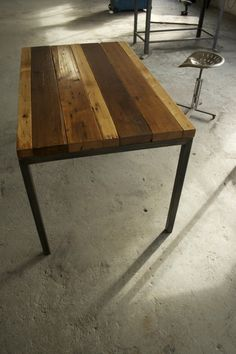 beautiful reclaimed wood table that could work for kitchen, office, outside...