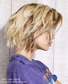 Long blonde bob with tapered cutting lines and messy styling.