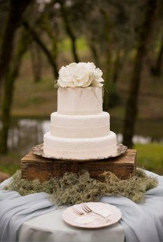 Wedding cake on silver platter, upside down crate and moss. (pinning this for the strip of lace on each layer! gorgeous!)
