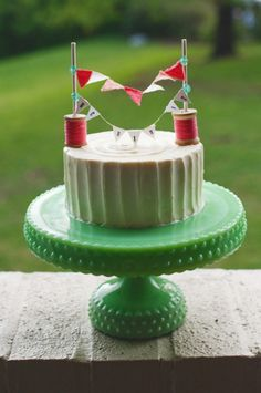 A frosted cake, served on a darling cake stand & topped with a fabulous topper- delightful! Diy Cake Topper, Cake Toppers, Cake Cookies, Cupcake Cakes, Sewing Cake, Cake Bunting, Cake Banner, Cake Plates, Cake Tray