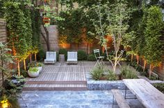 Garden design ideas: Low maintenance and family friendly, this Midwood backyard by Brook Landscape features a marble patio, wood deck and layered plantings. Back Gardens, Small Gardens, Modern Landscaping, Backyard Landscaping, Brooklyn Backyard, Townhouse Garden, Backyard Patio Designs, Patio Ideas, Garden Landscape Design