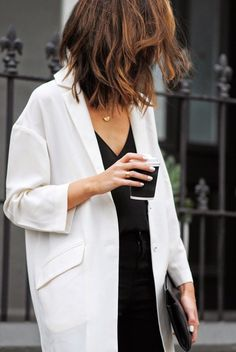 Love the hair, the white coat and nails, the simple black dress, everything about this look. Effortlessly stunning.