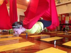 "Have you tried aerial yoga? Our Clinical Health Consultant Ashley learns how to ""trust herself"" and wrote about it for our blog!"