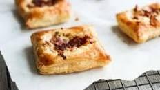 Onion & goat's cheese tarts recipe | BBC Good Food