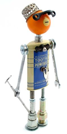 """The Dentalist""   Height: 13.5""   Principal Components: Tooth powder tin, pool ball, sink drain catch, sash lock, wrenches, dental mirror, hose fittings, button"
