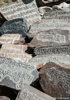 Landscape photography of tibetan buddhism om mani padme hum mantras carved in raw stones. Travel photography created during trekking from Dracha to Padum in Zanskar region of India.  Travel photography print / Meditation poster / Living room ethnic wall art / Buddhism wall decor / Yoga class ethnic poster / Tibetan buddhism mantras / Spiritual photography print / Om mani padme hum wall art ***** ALSO AVAILABLE AS PHONE CASE *****  Check out my listings avai...