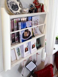 Dining storage that works! Use the wall space to store and show off your cooking inspiration high & mighty.