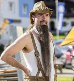 Long and wild: This man's two-foot long beard put the hipster beard trend to shame in terms of length and dedication Beards And Mustaches, Moustaches, Trimmed Beard Styles, Beard Styles For Men, Long Goatee, Beard Trend, Hipster Beard, Bald Men, Long Beards