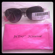 Betsey Johnson Aviator Sunglasses w/pink case Super fashionable silver/black aviator sunglasses. With gold BJ words around the sides (as shown in pic) 100%UV protection with bright pink BJ case. Betsey Johnson Accessories Sunglasses