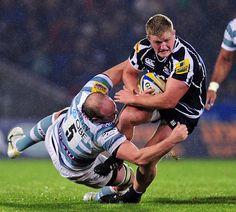 Sale's Ross Harrison breaks through the tackle of Irish's Matt Garvey