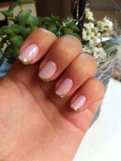 Light pink nails with gold details!