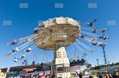 Spinning Carousel With People Blurred Against Blue Sky. Copyspace Stock Footage | Royalty-Free Stock Photo Library | 10383011