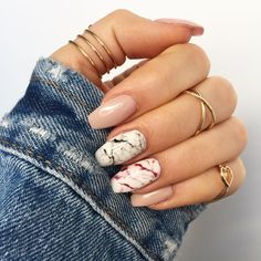 nude nails and two accent marble ones in black and red