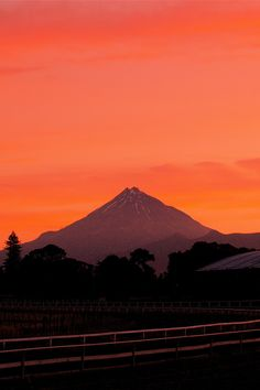 Taranaki volcano at sunset from the racecourse in New Plymouth, New Zealand.