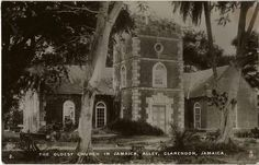 """Alley Church, The Oldest Church in Jamaica    This Anglican Church was founded between 1671 and 1675, as the parish church of Vere. It is lauded as being one of the oldest churches in the island. The present brick structure, which holds the Alley Church, was constructed around 1715 on the same grounds. This type of postcard is one of the """"Real Photograph"""" Series. As this title suggests, these were real pictures and was a format which gained popularity at the beginning of the 20th century."""