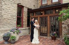 Bride and groom pose in the brick courtyard at Riverside Receptions and Conference Center, just outside of Chicago | Joy Lyn Photography