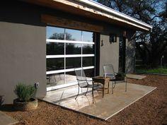 Glass Garage Door installed as a patio door- Hill Country Doors Modern Garage, Door Installation, Modern Patio Doors, Glass Garage Door, House Doors, Modern Patio, Garage Doors, Ranch Style Homes, House Front