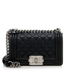 An iconic Chanel shoulder bag in quilted black calfskin with ruthenium hardware. Details include a modern CC turnlock and chunky chain and leather strap. This versatile design can be worn over the shoulder with the strap doubled-over, or crossbody with the strap extended.