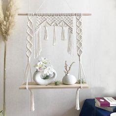 About: This macrame hanging shelf will be your favorite thing to look at once hung up in your room, living room and the options are endless. Macrame Wall Hanging Patterns, Macrame Plant Hangers, Macrame Patterns, Macrame Owl, Macrame Knots, Diy Hanging Shelves, Macrame Curtain, Macrame Design, Macrame Projects