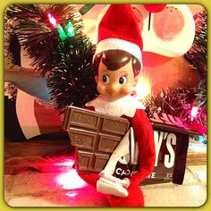 Elf on shelf eating a candy bar...or leave smores for the kids!!