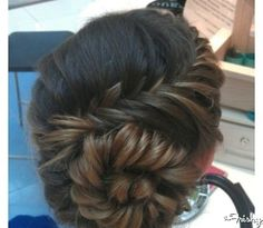 This is called a snail braid- an unattractive name for a beautiful look